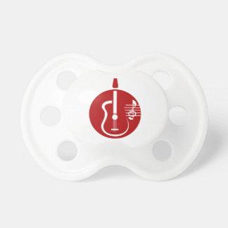 recorte abstracto de la guitarra con las notas red chupetes de bebe