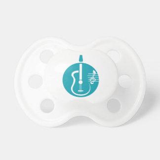recorte abstracto de la guitarra con las notas tea chupete de bebé