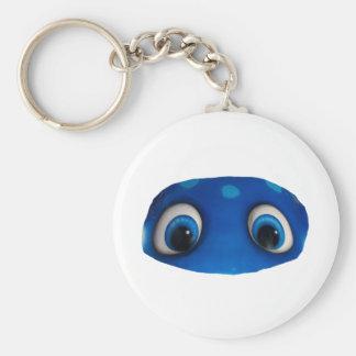 Recorte feliz del azul de los ojos llavero redondo tipo pin