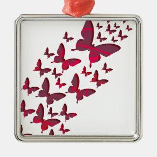 Recortes rojos de la mariposa adorno navideño cuadrado de metal
