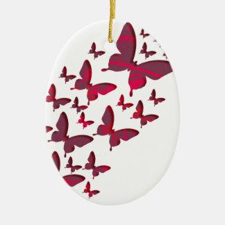 Recortes rojos de la mariposa adorno navideño ovalado de cerámica