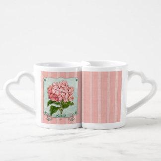 Recortes rosados del papel rayado de la cinta del tazas para enamorados