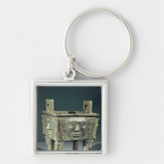 Rectangular 'ting' vessel with human faces keychain
