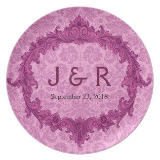 Recuerdo del boda con el marco rosado del vintage platos