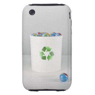 Recycling bin with full of globes. iPhone 3 tough covers