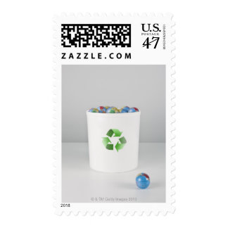 Recycling bin with full of globes. postage stamp