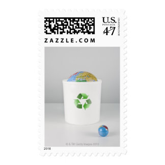 Recycling bin with globes. postage stamp