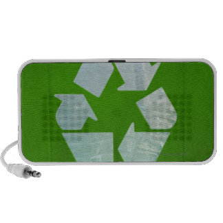 Recycling logo cut out of green plastic mp3 speakers
