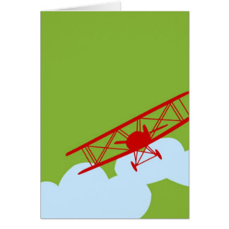 Red airplane on plain lime green. card