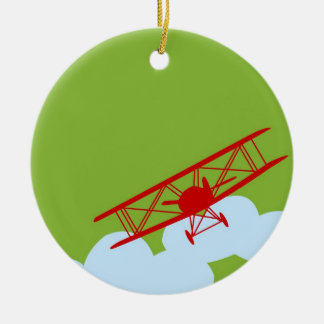 Red airplane on plain lime green. ceramic ornament