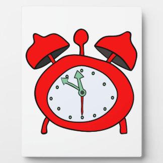 red alarmclock display plaque