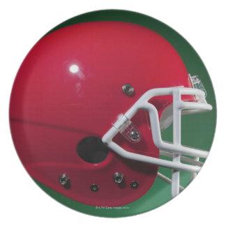 Red American football helmet on green background Melamine Plate
