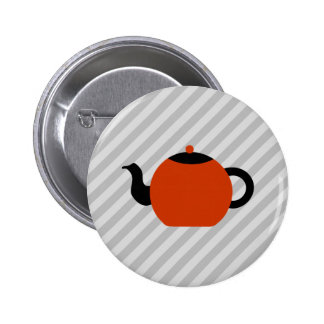 Red and black teapot design, on gray stripes. button