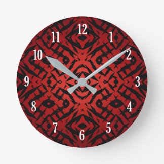 Red and black tribal shapes pattern round clock