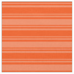 [ Thumbnail: Red and Coral Lined Pattern Fabric ]