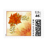 Red and gold autumnal leaves postage