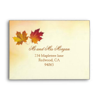 Red and gold autumnal maple leaves envelope
