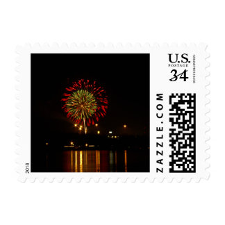 red and green fireworks explode over Mississippi Postage
