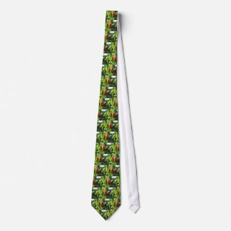 Red and green peppers hanging on the plant neck tie