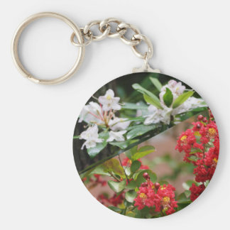 Red and white wild flowers are growing together keychain