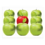 Red apple among green apples postcard