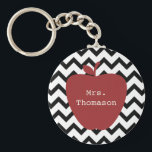 "Red Apple Black &amp; White Chevron Teacher Keychain<br><div class=""desc"">A gift for teachers featuring an illustration of a red apple over a black and white chevron pattern.  Personalize with your name on apple.</div>"