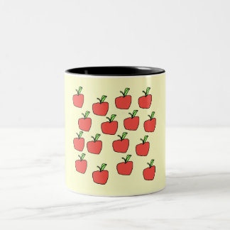 Red apple pattern, on cream. coffee mug