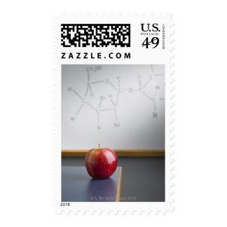 Red apple sitting on teachers desk stamps