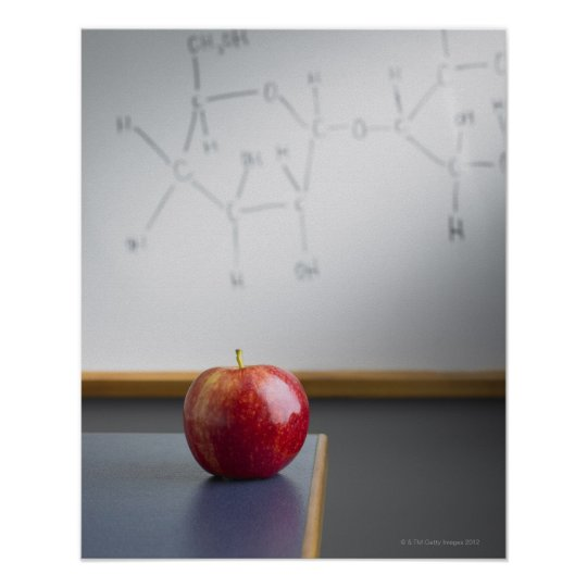 Red apple sitting on teachers desk poster
