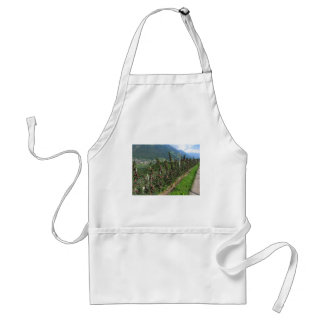 Red apple trees on a background of mountains apron