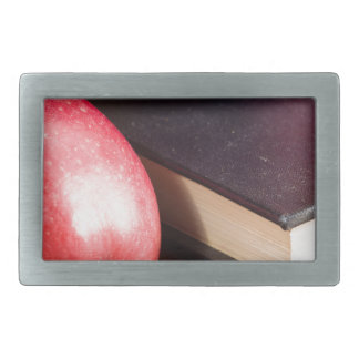 Red apples and old vintage book rectangular belt buckle