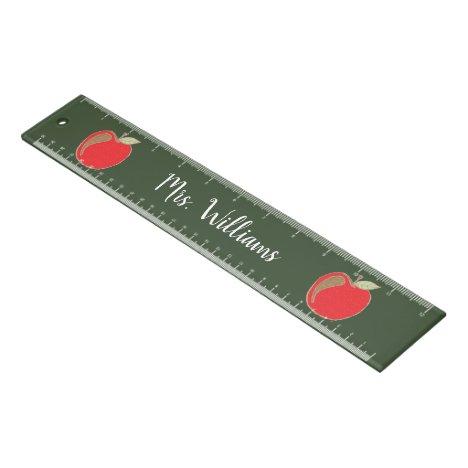 Red apples on faux chalkboard teacher ruler