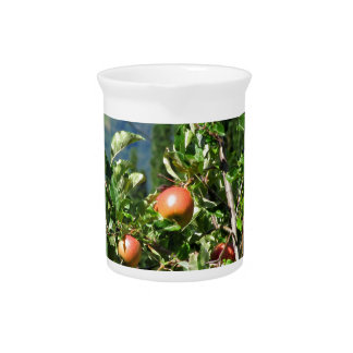 Red apples on tree branches drink pitcher