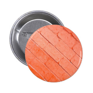 Red background of bricks on a diagonal image 2 inch round button