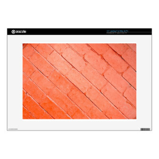 """Red background of bricks on a diagonal image skins for 15"""" laptops"""