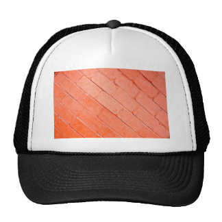 Red background of bricks on a diagonal image trucker hat