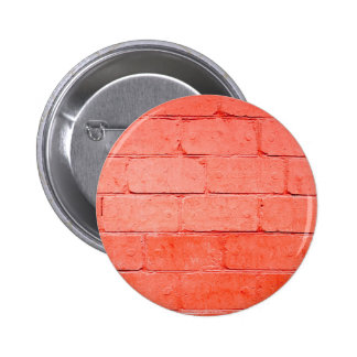 Red background of bricks with a layer of paint 2 inch round button
