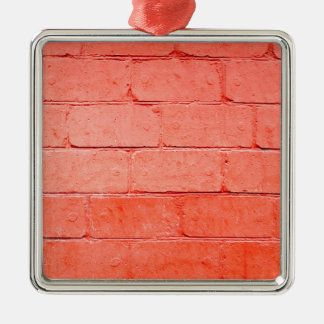 Red background of bricks with a layer of paint metal ornament