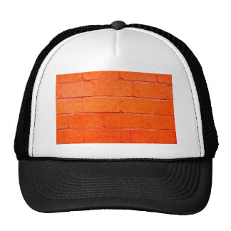 Red background of bricks with a layer of paint trucker hat
