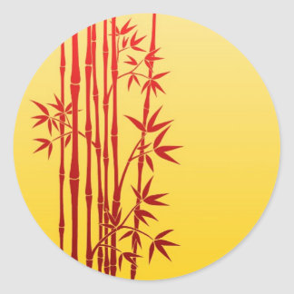 Red Bamboo Sticks with Leaves on Yellow Classic Round Sticker