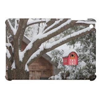 Red barn birdhouse on tree in winter iPad mini cover