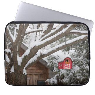 Red barn birdhouse on tree in winter laptop sleeve