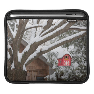 Red barn birdhouse on tree in winter sleeves for iPads