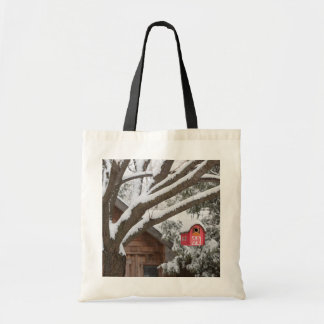 Red barn birdhouse on tree in winter tote bag
