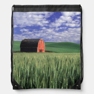 Red barn in wheat & barley field in Whitman 2 Backpack
