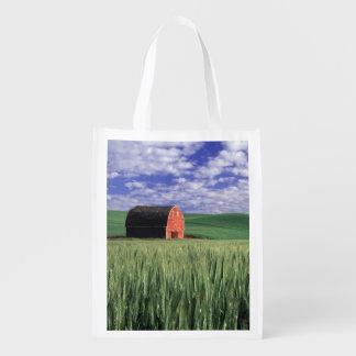 Red barn in wheat & barley field in Whitman Grocery Bag