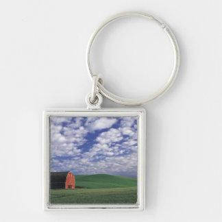 Red barn in wheat & barley field in Whitman Keychain