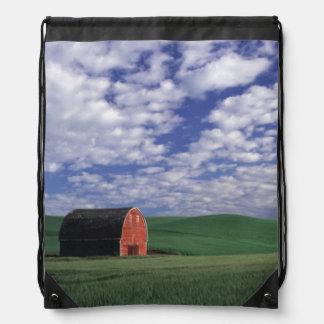 Red barn in wheat & barley field in Whitman Cinch Bags