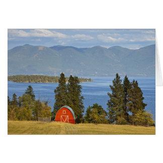 Red barn sits along scenic Flathead Lake near Greeting Card