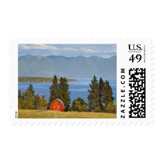 Red barn sits along scenic Flathead Lake near Postage Stamps